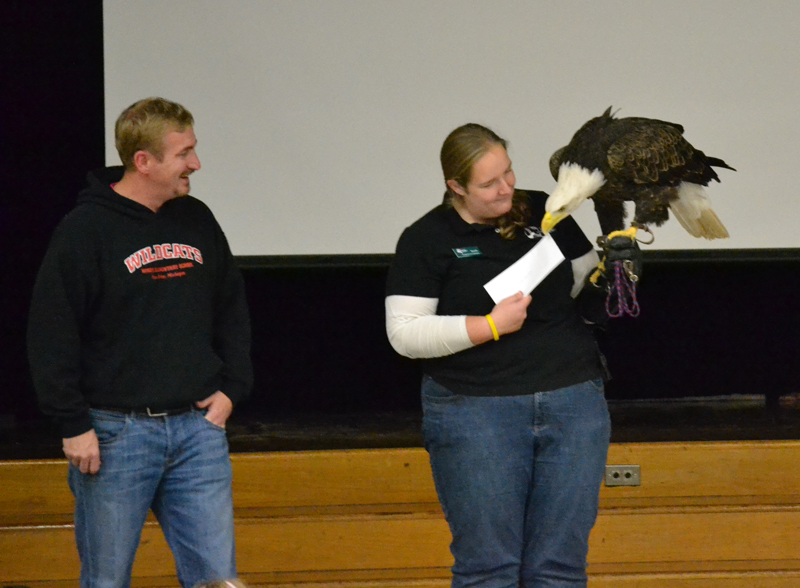 The eagle graciously accepted the donation check.