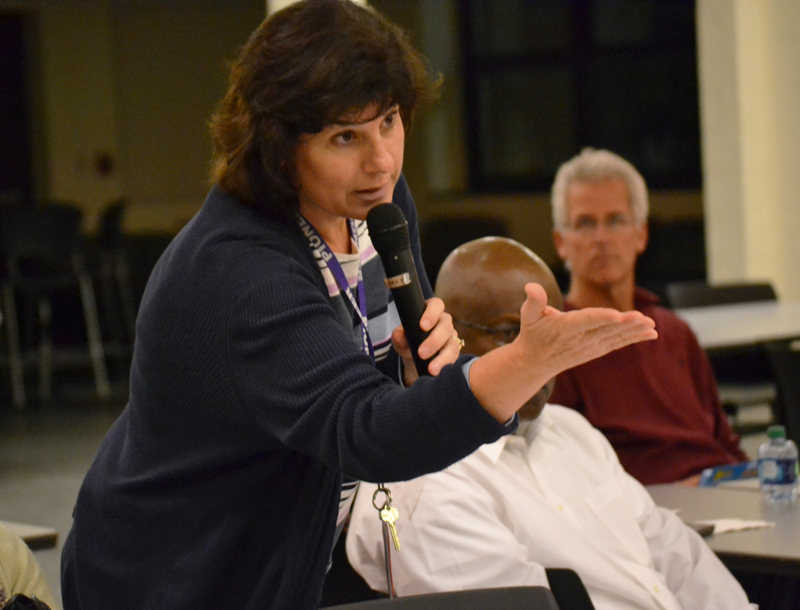 A parent shares her group's discussion at Pioneer's Listen and Learn forum on Nov. 7, 2013.