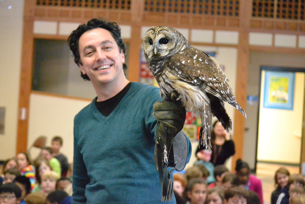 Cranbrook Science Institute's Rob Mies shows off Sam, a barred owl, to Bach Elementary students Dec. 18, 2013.