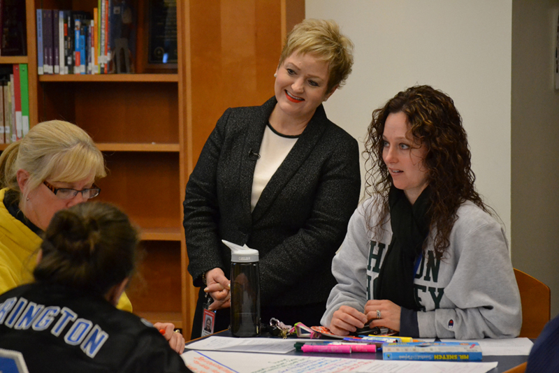 Dr. Swift listens to Tappan staff at the Dec. 16 Listen and Learn stop.