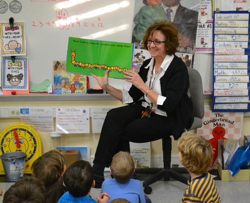 Patty Zeichmann reads aloud to her kindergarteners on Jan. 14, 2014.