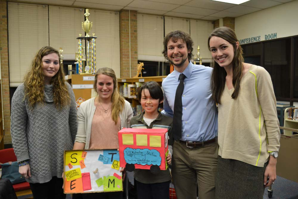 The entrepreneurial team behind the STEMotivation Station: Marah Casey, Detroit Public Schools teacher at U-M graduate student; Tom Jubert, second grade teacher and U-M graduate student; fifth grader Kyle; Alex Keyser, a U-M senior in industrial engineering; Carolyn Sullivan, U-M sophomore.