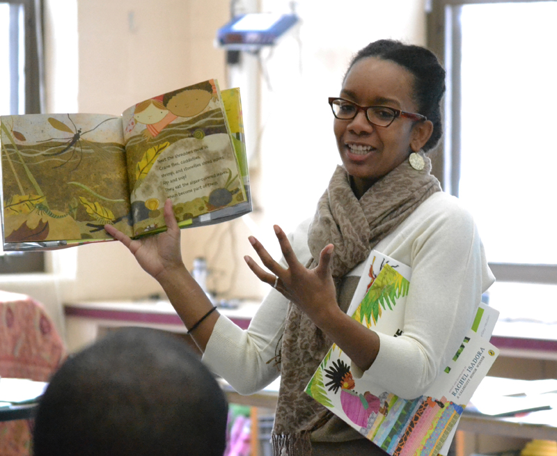 Dr. Shayla Griffin talks with Bryant and Pattengill parents about the benefits of multicultural children's books. She brought her own extensive collection to share.