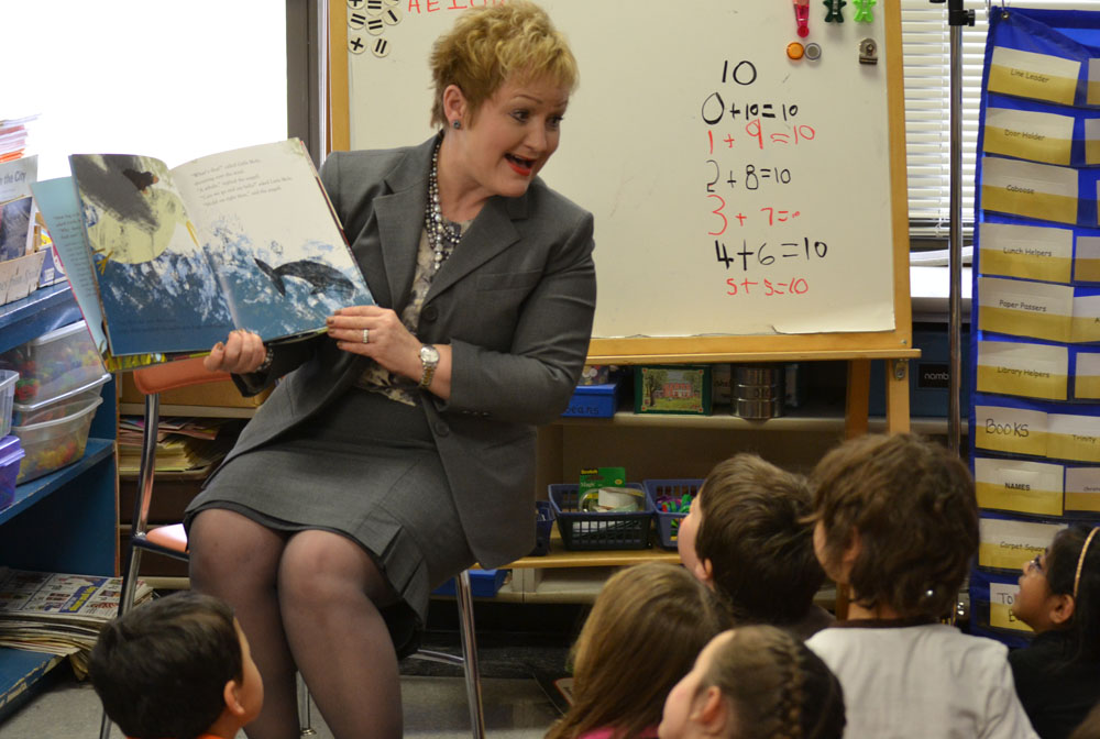 "Dr. Swift reads ""How Big Is The World"" to Jan Smith's kindergarten class at Northside Elementary, March 25, 2014."