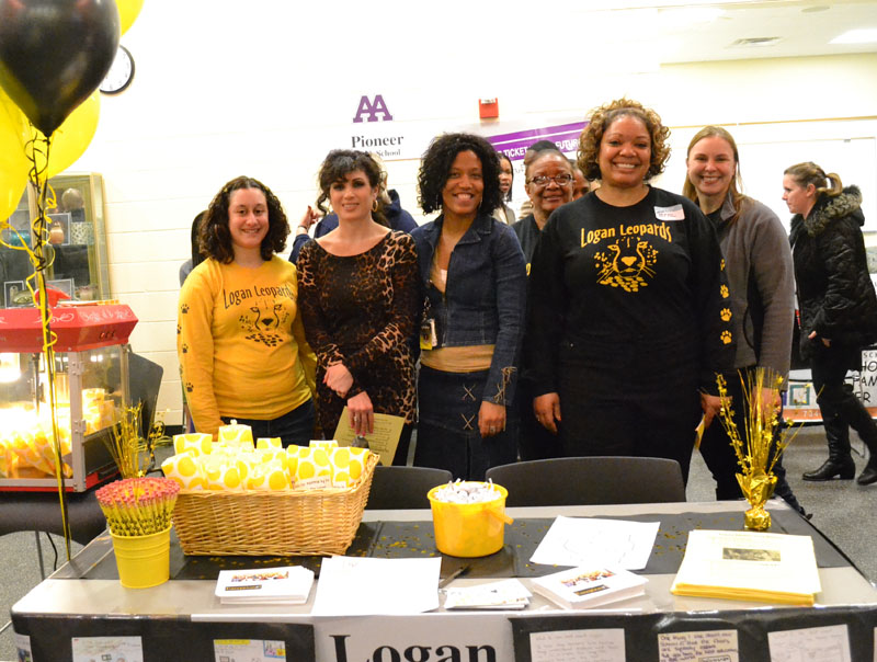 Logan staff stand proudly by their booth at the Schools of Choice Open House.