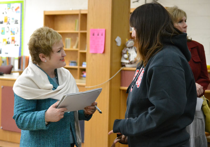Dr. Swift chats with a Huron High School student after a community budget meeting on March 27 at Scarlett Middle School.