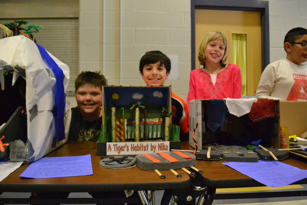Third graders proudly show off their exhibits on Friday, March 21, 2014.