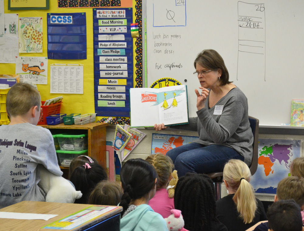 Susan Woodard reads to Susan Baily's class on March 20, 2014.