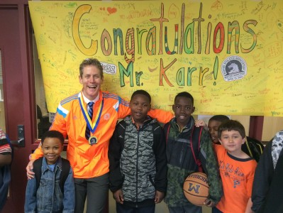 Mitchell students congratulate Kevin Karr