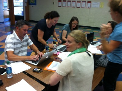 Bach staff working with this year's Theme: Lead Care Inspire!