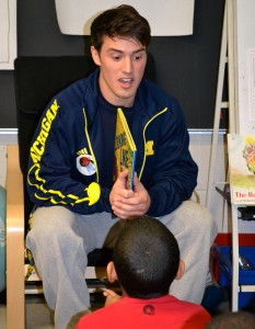 Lacrosse player Paxton Moore reads to the students.