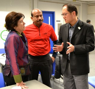Pioneer High School Math Department Chair Michele Macke talks with V. Harindranath and Chow Weisi.
