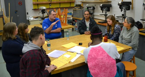 Peter Winkler, Network Management Systems Automation Developer at Ford Motor Company, speaks to the group. Clockwise around the table are Amit Lathia, senior engineer at NSF International; student Dorothy H; Bondy; and students Layan K.; Da'zanna G. and Ethan W.