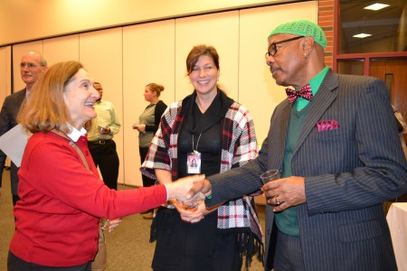 Executive Director for Elementary Education Dawn Linden (center) introduces Nellie Guibert, a special education T.A. at Pioneer High School, to NAACP-Ann Arbor Branch President William Hampton.