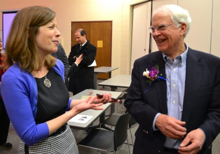 Community Education & Recreation Executive Director Jenna Bacolor shares a laugh with Glenn Nelson.