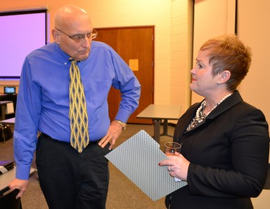 Former trustee Bob Rorke chats with Superintendent Jeanice Swift during the reception.