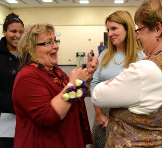 Irene Patalan chats with incoming trustee       and Ann Arbor Open Principal Kit Flynn. On the far left is Angela Johnson, special education T.A. at Haisley Elementary.