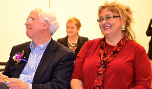 Glenn Nelson and Irene Patalan listen to tributes at a reception in their honor.