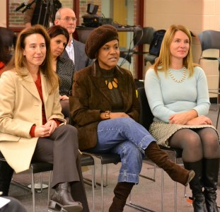 Trustees Christine Stead and Simone Lightfoot and incoming trustee listen to a tribute.