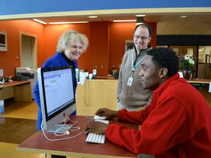 Senior Jonathon Muir-Cotton chats with Sara Duvall and Peter Pasque in the iCommons at Skyline High School.