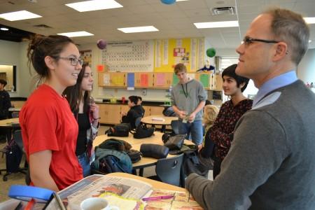 Sarika Taygi talks with Skyline teacher Jeff Bradley  prior to the SkyWell Club meeting.