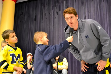 Lakewood students      and     (with mic) took turns asking questions of the athletes. Here,   tries to recall his favorite subject in grade school.