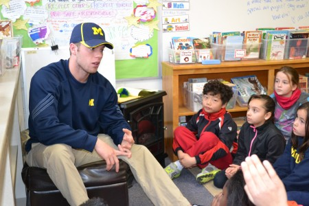 Travis Maezes tells the kids about his love of baseball.