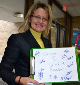 Principal Michelle Seals collected autographs from the players to give to Noah, a student  who was upset because he was too sick to attend school on the day the team came to visit.