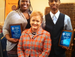 AAPS Superintendent Jeanice Swift congratulates Skyline students Mariah Gregory and Myles McGuire for winning the Harold Eastman Outstanding Youth Achievement Award from the Breakfast Optimist Club of Ann Arbor.