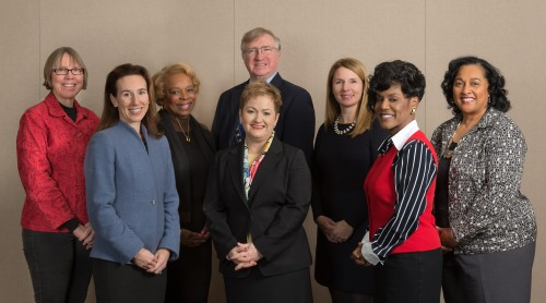 Superintendent Jeanice Swift, center, stands with the Ann Arbor School Board. Left to right are trustees Deb Mexicotte, president; Christine Stead, vice president; Patricia Manley; Andy Thomas, secretary; Donna Lasinski, treasurer; Simone Lightfoot; and Susan Baskett.