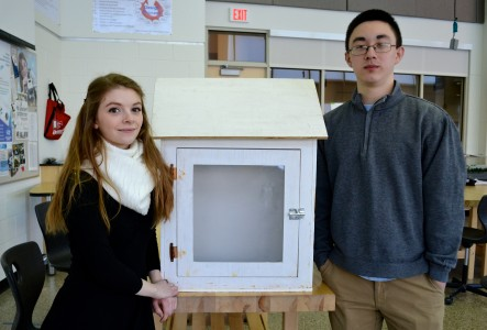 Lisa Read and Anton Draayer stand before the prototype they built of a little neighborhood library.