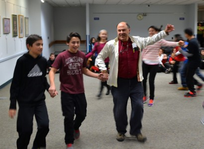 Teacher Jeff Gaynor joins in the troika with his students.