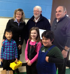 Lakewood Elementary Principal Michelle Seals is photographed  with Western Kiwanis member Richard Pitcher and President, Charlie Phibbs after receiving the calculators from the club.