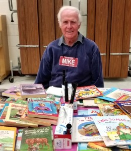 Mike Conboy brings free books for the students.
