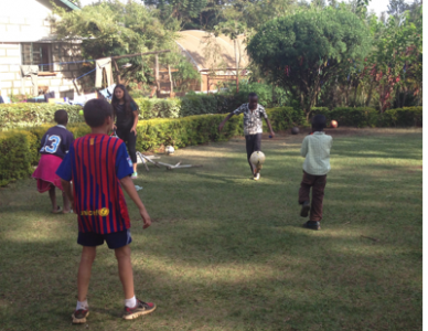 Anjuli plays ball with Patrick and friends in Kenya.