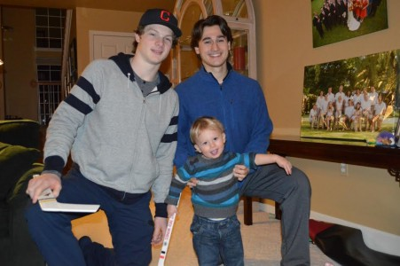 Trent Frederic and Chad Krys meet Birko's grandson, Henry, over the holidays.