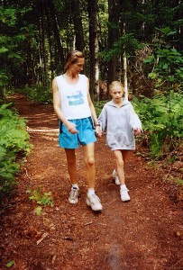 Chelsea was influenced by her mother's healthy habits as she grew up. They're shown here enjoying a family walk in the woods about 15 years ago. (Photo by Dwight Cendrowski.)
