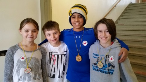 Fifth graders Dawsen, Kyle, Rohit and Francis welcome donors to the blood drive.