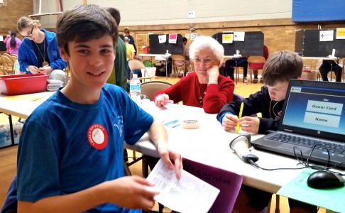 Tappan student Josh Martins-Caulfield helps out at the blood drive, as he does every year.