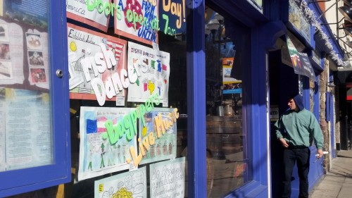 St. Patrick's Day signs compete with AAPS art in the window at Conor O'Neill's.