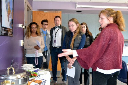Beth Skochelak of Katherine's Catering—one of two local catering companies under consideration for the Pioneer Senior Prom—talks to staff and students about the menu.