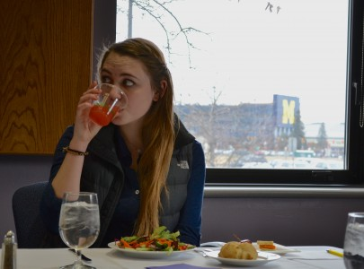 Senior Julien Heidt, Pioneer High School social committee co-chair, tests the punch that would be served at the prom.