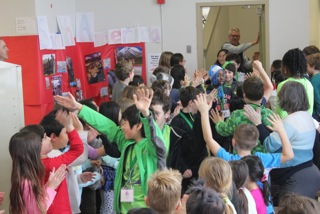 "The winners were welcomed back to school after the three-day competition with a ""clap-in."" (Photo by Kirsten Haenle)"