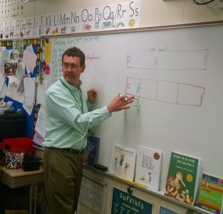 Tom Clarkson teaching fractions to his second grade class at King Elementary.