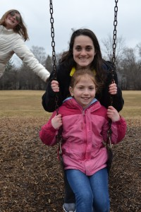U-M soccer player Jen Pace enjoys some playground time with her pen pal, Sophia Riegle.