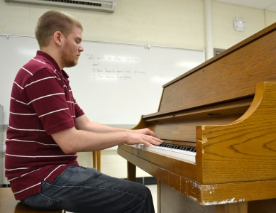 Scarlett Middle School choir teacher Cory Bergman at the piano he says badly needs to be replaced.