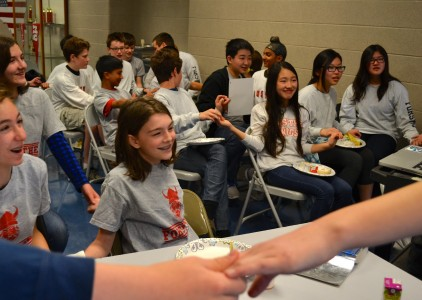 Club members are photographed during a warm-up science experiment prior to the competition.