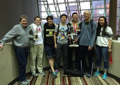 From left to right are Coach Ken Long; Alexander Deatrick; Franklin Bromberg; Marco Lorenzo; Jeffery Zhang; Justin Chen; and Joy Chen.