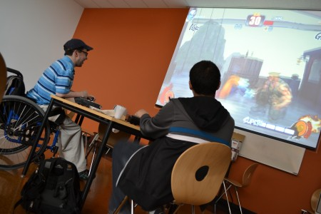 "Students compete in a ""Super Smash Brothers Project M"" smash-off."
