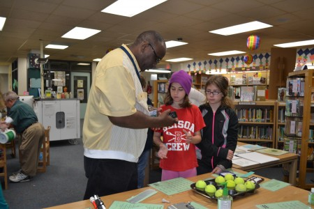 Kenneth shows students what it's like to read Braille.